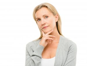 woman wondering are dental implants worth the cost